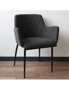 Chaise à accoudoir et coutures en diagonales