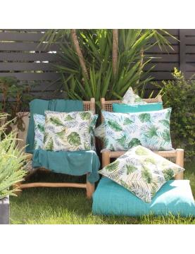 Coussin outdoor au style jungle botanique
