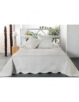 Jeté de lit aux formes géométriques surpiquées