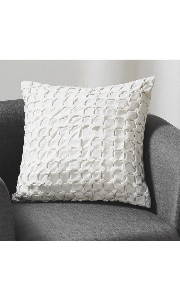 Coussin en toile de coton et jeu de plis ivoire